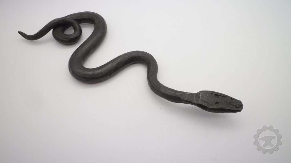 Metalen kronkelende speelgoed slang